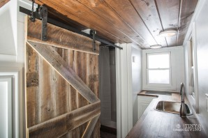 """Rustic Country Barn Sliding Bathroom Door featured in """"The Roving"""" (Source: 84 Tiny Houses)"""